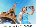Stock photo happy travel woman in paris with eiffel tower and she take a selfie picture asian beauty 261803048