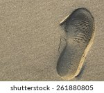 A Shoe Print In The Sand ...