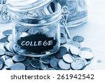 Saving Money Into Glass Jar Fo...