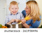 happy mother with her son... | Shutterstock . vector #261958496