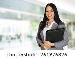 businesswoman working at her... | Shutterstock . vector #261976826