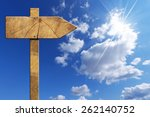 wooden directional sign on blue ...