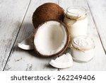 fresh coconut oil in glassware... | Shutterstock . vector #262249406