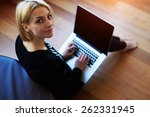 lovely young woman working on... | Shutterstock . vector #262331945