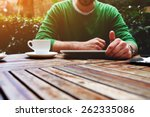 front view young man sitting at ... | Shutterstock . vector #262335086