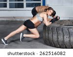 man and woman on a tire fitness ... | Shutterstock . vector #262516082