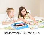 siblings  a boy and girl play a ... | Shutterstock . vector #262545116