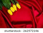 Yellow Tulips Lying On Red...