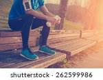 tired athlete resting on the... | Shutterstock . vector #262599986