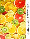 sliced fruits background | Shutterstock . vector #262628162