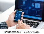 man holding the phone with... | Shutterstock . vector #262707608