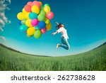 happy girl jumping with... | Shutterstock . vector #262738628