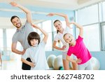 family exercising. happy sporty ... | Shutterstock . vector #262748702