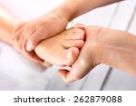 foot massage in the spa salon... | Shutterstock . vector #262879088