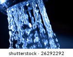 Closeup of water coming out of faucet - stock photo