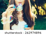 Girl Blowing Bubbles Outdoor....