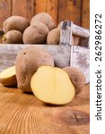potatoes in a wooden box | Shutterstock . vector #262986272