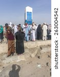 Small photo of MECCA, SAUDI ARABIA - MAR 11: Muslims at Mount Arafat (or Jabal Rahmah) March 11, 2015 in Arafat, Saudi Arabia. This is the place where Adam and Eve met after being overthrown from heaven.