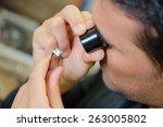 jeweller appraising a ring | Shutterstock . vector #263005802