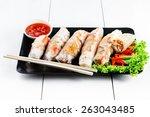 spring rolls with vegetables... | Shutterstock . vector #263043485