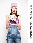 hipster girl with a photo... | Shutterstock . vector #263063942