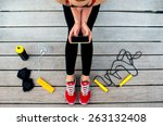 sporty woman holding phone with ... | Shutterstock . vector #263132408