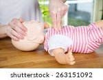 woman performing cpr on baby... | Shutterstock . vector #263151092