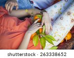 woman's hand holding orange | Shutterstock . vector #263338652