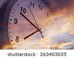 clock face in bright sky | Shutterstock . vector #263403035