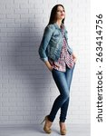 pretty girl dressed in casual... | Shutterstock . vector #263414756