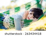 Thoughtful Child In Hammock