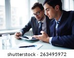 two businessmen working with... | Shutterstock . vector #263495972