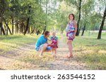 happy family in park | Shutterstock . vector #263544152