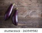 purple eggplants on wooden... | Shutterstock . vector #263549582
