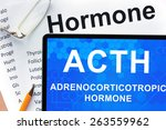 Small photo of Papers with hormones list and tablet with words adrenocorticotropic hormone (ACTH).