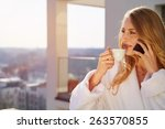 drinking coffee at home.... | Shutterstock . vector #263570855