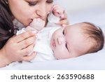 young happy beautiful mother... | Shutterstock . vector #263590688