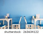 blue dining table with blue wall | Shutterstock . vector #263634122