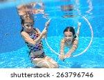 happy children swim in pool... | Shutterstock . vector #263796746
