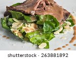 white dish with beef salad and... | Shutterstock . vector #263881892