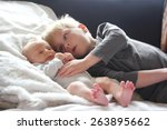 a big brother is lovingly... | Shutterstock . vector #263895662