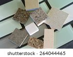 Stock photo glass subway tile samples used in kitchen backsplashes and quartz samples for countertops 264044465