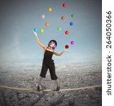 Clown As Juggler Is Balancing...