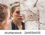 teen girl looking at her... | Shutterstock . vector #264056435