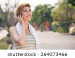 active woman with earphones... | Shutterstock . vector #264073466