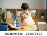 curious vietnamese girl pouring ... | Shutterstock . vector #264079502
