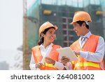 happy engineer and his female...   Shutterstock . vector #264081002