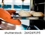 baker hands with potholder next ... | Shutterstock . vector #264269195