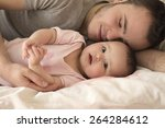 portrait of father  with baby... | Shutterstock . vector #264284612