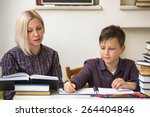 young student learns at home... | Shutterstock . vector #264404846